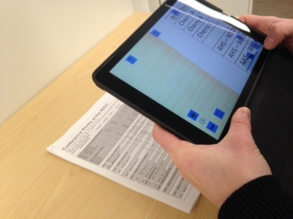 Using the VisionAssist app to magnify a printed page